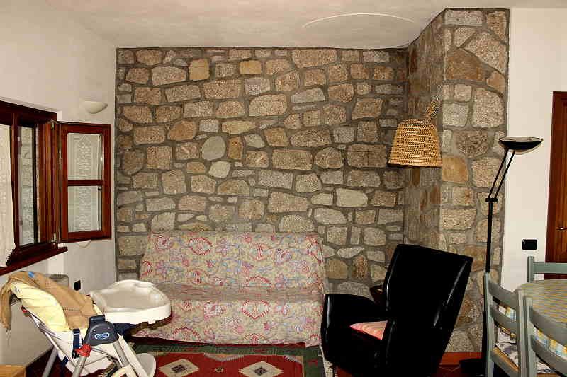 Soggiorno con divano letto, poltrona ed altri posti a sedere